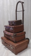 Trolley with Old Brown Suitcases